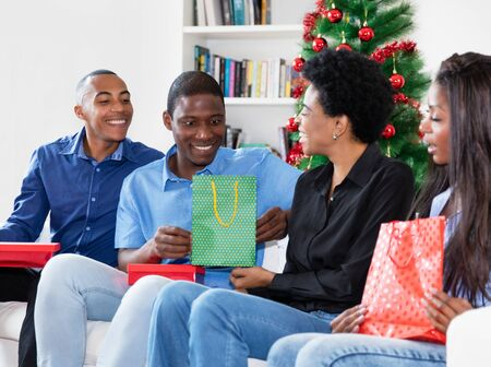 Beautiful african african family celebrating christmas with gifts and presents Stockfoto