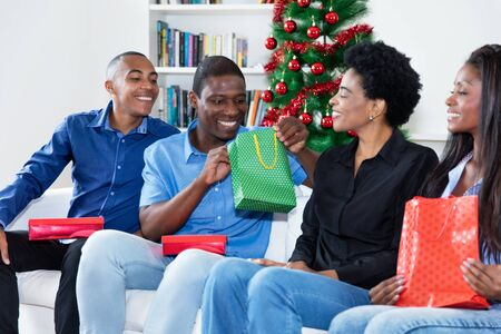 African african people celebrating christmas with gifts and presents