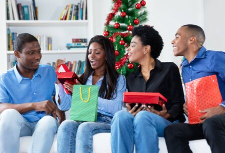 Happy african african family celebrating christmas with gifts and presents