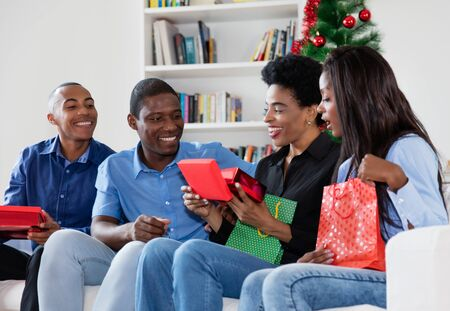 African african family celebrating christmas with gifts and presents Stockfoto