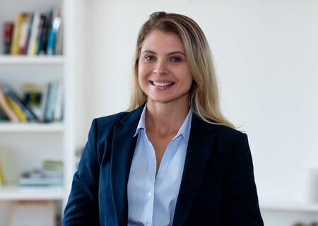 Portrait of beautiful blond businesswoman with blazer