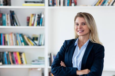 Laughing blond businesswoman with blazer