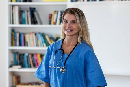 Portrait of laughing blond nurse