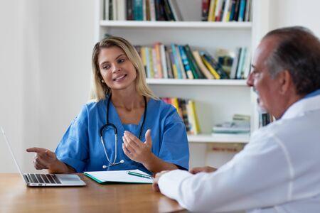 Pretty blond nurse talking with doctor