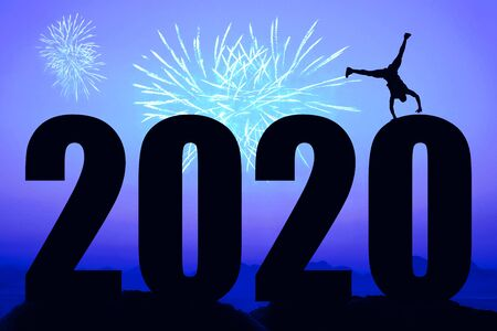 Blue night with fireworks and new year 2020 and dancing man