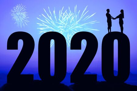 Blue night with fireworks and new year 2020 and couple in love Stock Photo
