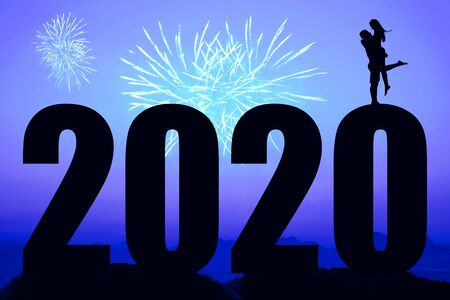 Blue night with fireworks and new year 2020 and love couple
