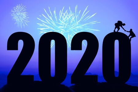 Blue night with fireworks and new year 2020 and helping hands