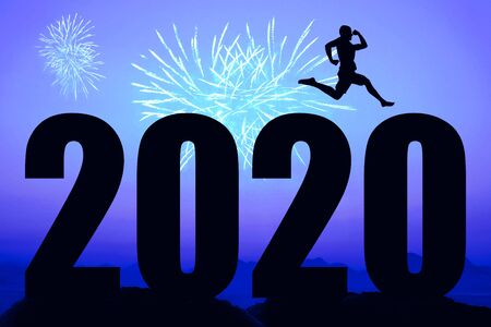 Blue night with fireworks and new year 2020 and sporty running man