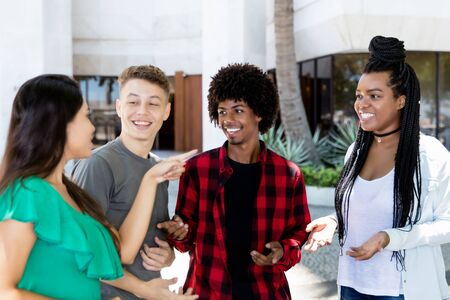 Latin and caucasian and african american young adult people in discussion