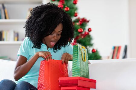 Beautiful african american woman with christmas presents Stock Photo