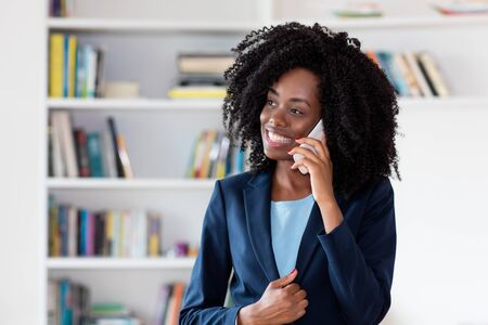 African american businesswoman with business blazer talking with client Фото со стока - 131824716