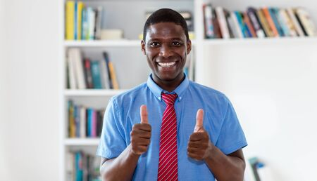 Motivated african american businessman showing thumbs up Stockfoto