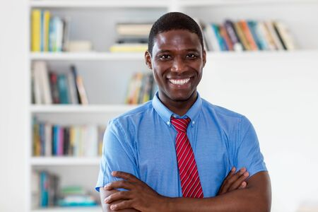 Laughing african american businessman with tie and copy space