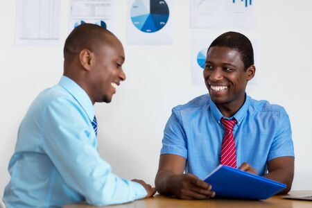African american business people talking about business strategy
