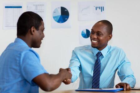 Handshake of african american businessmen after job interview