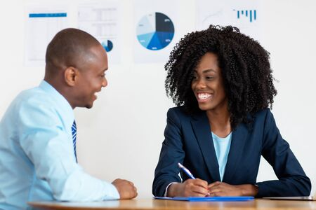 African american businesswoman signing contact for new job