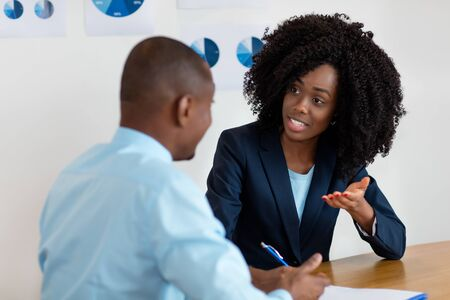 African american businesswoman talking with customer about contract