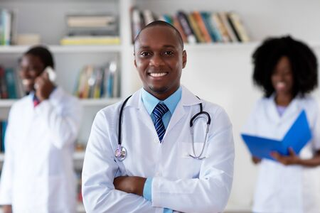 African american mature doctor with medical team Stockfoto