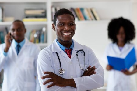 African american mature general practitioner with medical team Stockfoto