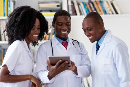 Team of african american doctors talking about patient
