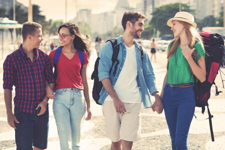 Group of american backpacker and tourists couple walking in the city