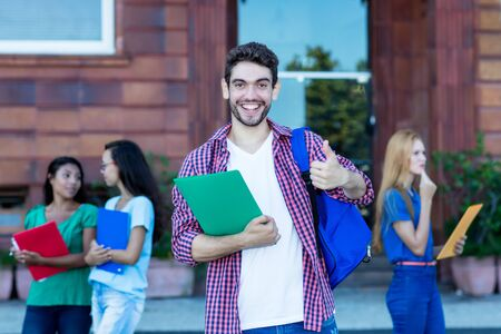 Successful hipster male student with group of young adults Stockfoto