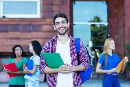 Hipster male student with group of young adults Banque d'images - 132554629