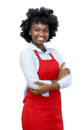 Laughing african american waitress with red apron Standard-Bild