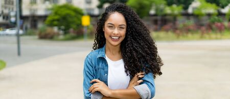Brazilian girl with curly hair and braces and copy space