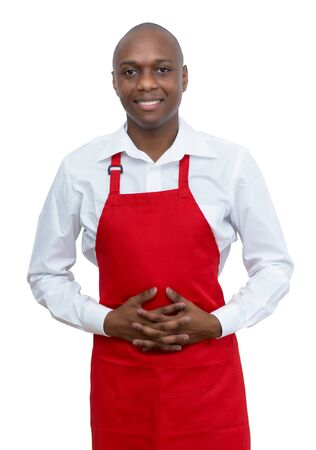 Handsome african american waiter with red apron Standard-Bild