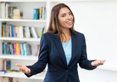 Laughing hispanic female business trainee