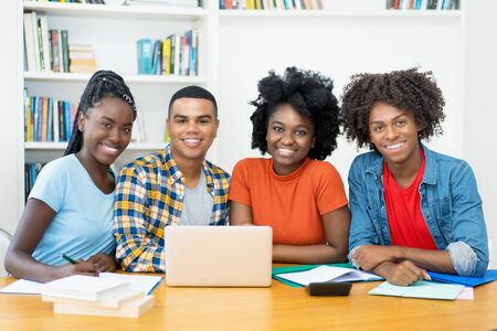 Group photo of african american and latin students at computer