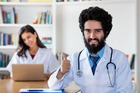 Optimistic arabic male doctor with nurse