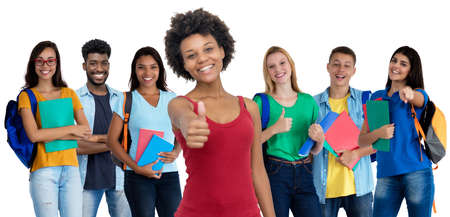 Pretty african american young adult woman with large group of international students