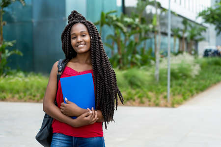 Young african american female student with amazing hairstyle