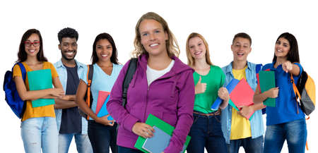 German young adult woman with large group of international students