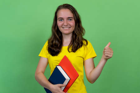 Successful german female student showing thumb up