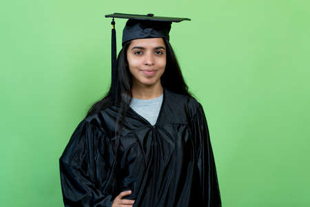 Beautiful indian graduate student with academic dress and hat