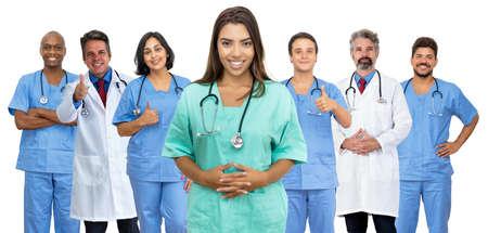 Beautiful latin american female nurse with doctor and medical team Foto de archivo