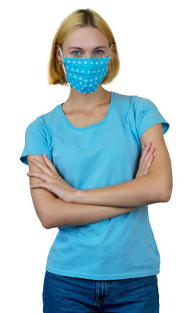 Pretty young woman with blond hair and homemade face mask as protection against covid-19 infection isolated on white background for cut out Imagens