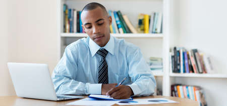 African american businessman stay at home and writing notes
