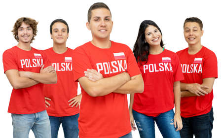 Young football fan from Poland with group of polish supporters isolated on white background for cut out 免版税图像