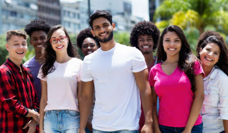 Youth of South America - Latin and hispanic and african american and caucasian young adults outdoor in summer in city 免版税图像