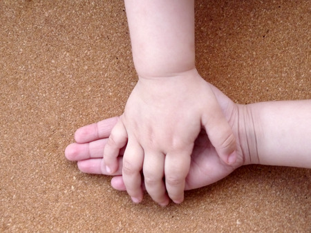 hand holding together Stock Photo
