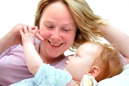 Young smiling mother playing with baby and looking at her with tenderness Stock Photo - 4931171