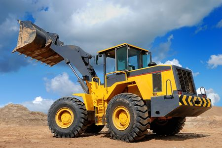 diesel wheel loader with risen bucket outdoors photo