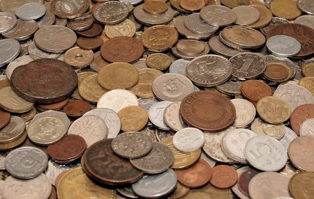 collection of modern and ancient coins of different countries photo