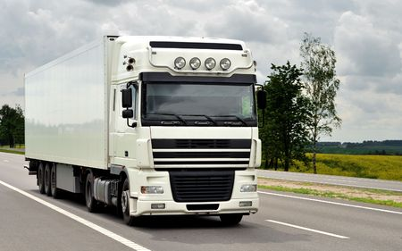 single white truck on the highway (front view) photo