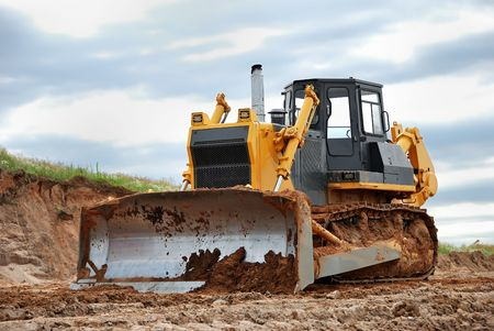 heavy bulldozer standing on the ground outdoors Stock Photo - 5043050